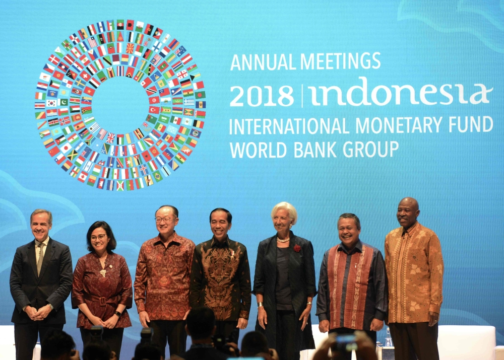 Indonesia's President Joko Widodo (C), World Bank president Jim Yong Kim (3rd L), and International Monetary Fund chief Christine Lagarde (3rd R) and others pose for a group photo during a seminar at the International Monetary Fund (IMF) and World Bank annual meetings in Nusa Dua on Indonesia's resort island of Bali on Thursday. — AFP