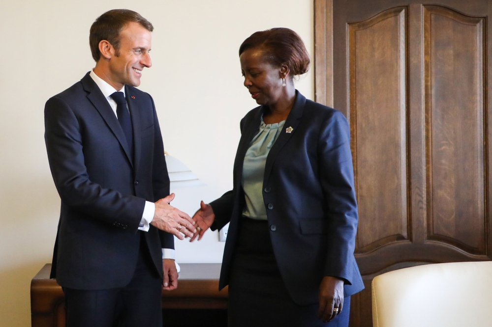 French President Emmanuel Macron meets with newly elected Secretary General of the International Organisation of French-speaking countries (OIF), Rwandan Foreign Minister Louise Mushikiwabo on the sidelines of the 17th Francophone countries summit in Yerevan on Friday. — AFP