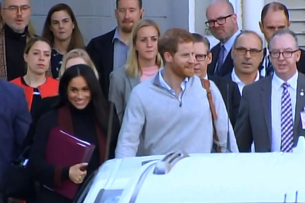 This frame grab from ABC video footage taken on Monday shows Britain's Meghan, Duchess of Sussex (front L) and her husband Britain's Prince Harry, Duke of Sussex (front C), as they arrive in Sydney. — AFP