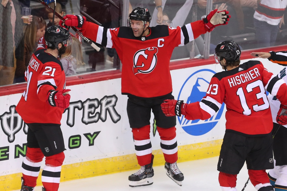 New Jersey Devils right wing Kyle Palmieri (21) celebrates with teammates after scoring a goal during the third period against the San Jose Sharks at Prudential Center. — Reuters