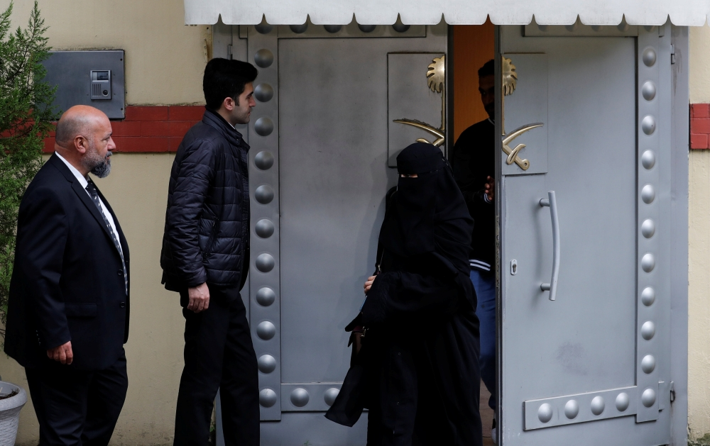 Saudi citizens leave Saudi Arabia's consulate in Istanbul on Monday. — Reuters
