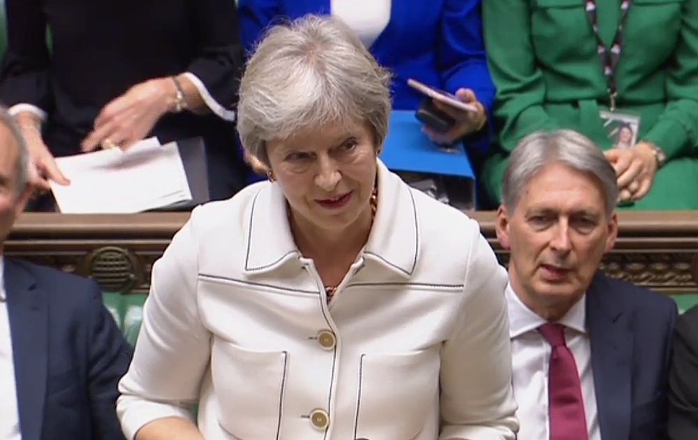 A video grab from footage broadcast by the UK Parliament's Parliamentary Recording Unit (PRU) shows British Prime Minister Theresa May speaking in the House of Commons on the latest progress on exit negotiation talks with the EU, in London on Monday. — AFP