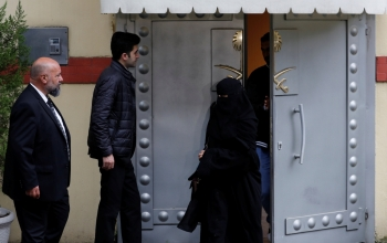 Saudi citizens leave Saudi Arabia's consulate in Istanbul on Monday. — Reuters