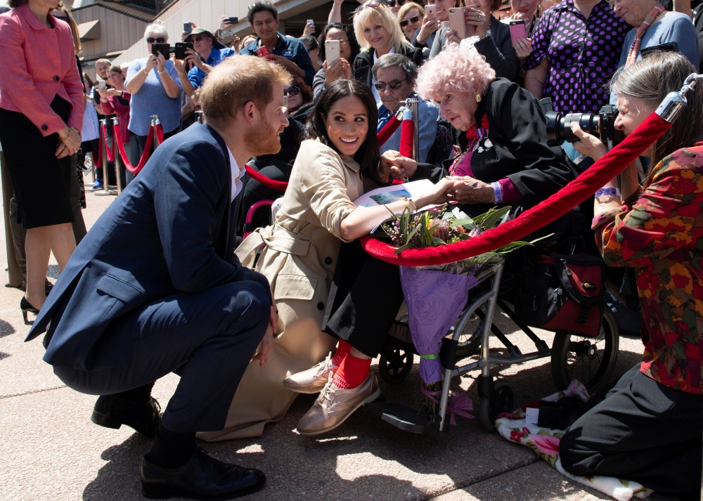 Meghan, Duchess of Sussex and Prince Harry, Duke of Sussex meet Daphne Dunne during a visit at the Sydney Opera House in Sydney, Australia, on Tuesday. — Reuters