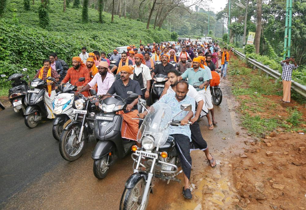 Hindu devotees take part in a motorcycle rally as part of a protest against the lifting of ban by Supreme Court that allowed entry of women of menstruating age to the Sabarimala temple, at Nilakkal Base camp in Pathanamthitta district in the southern state of Kerala, India, on Tuesday. — Reuters