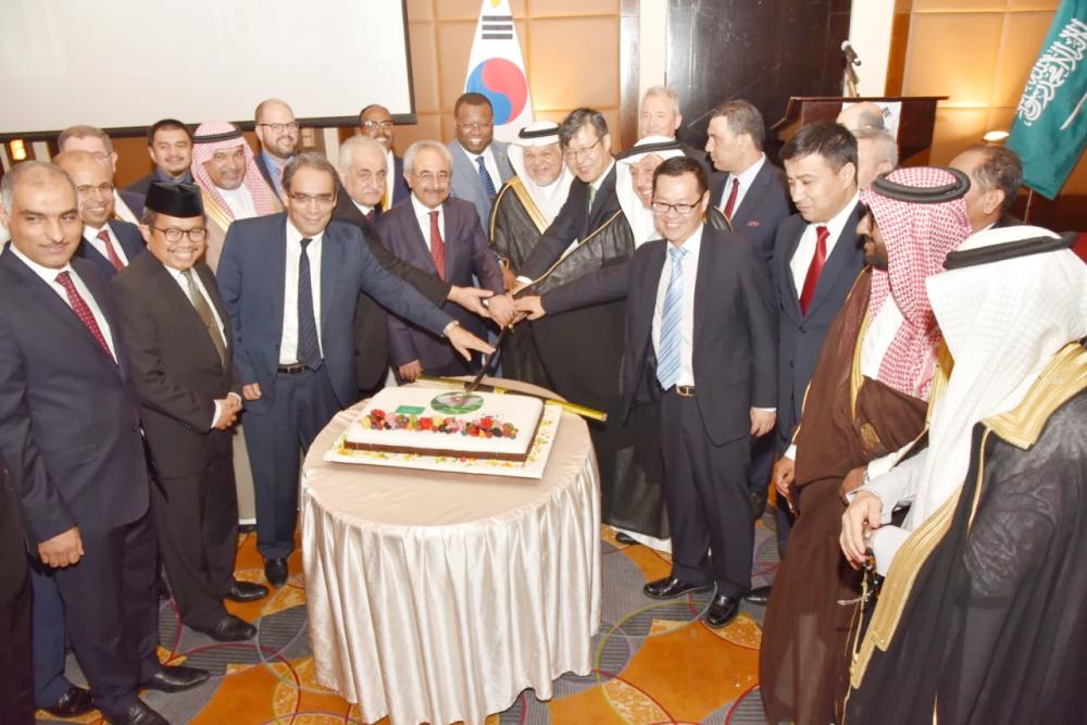 South Korea Consul General Sang-Kyoun Lee along with Foreign Ministry's Director Jamal Balkhoyour and diplomats jointly cutting cake to mark Korean National Day. — SG Photo by Irfan Mohammed