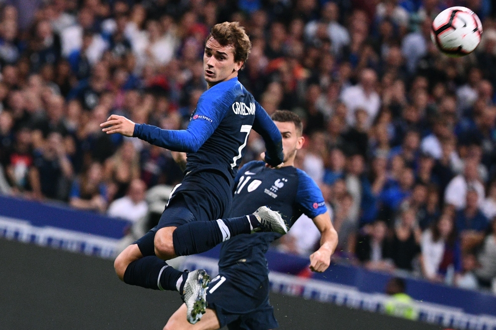 France's forward Antoine Griezmann heads the ball during the UEFA Nations League football match against Germany at the Stade de France in Saint-Denis, near Paris, Tuesday. — AFP