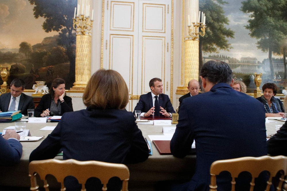French President Emmanuel Macron, center, gestures as he chairs the weekly Cabinet meeting at the Elysee Palace in Paris on Tuesday. — AFP