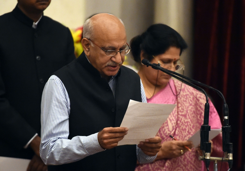 Bharatiya Janata Party (BJP) politician M.J. Akbar takes the oath during the swearing-in ceremony of new ministers following Prime Minister Narendra Modi's Cabinet re-shuffle at the Presidential Palace in New Delhi in this July 5, 2016 file photo. — AFP