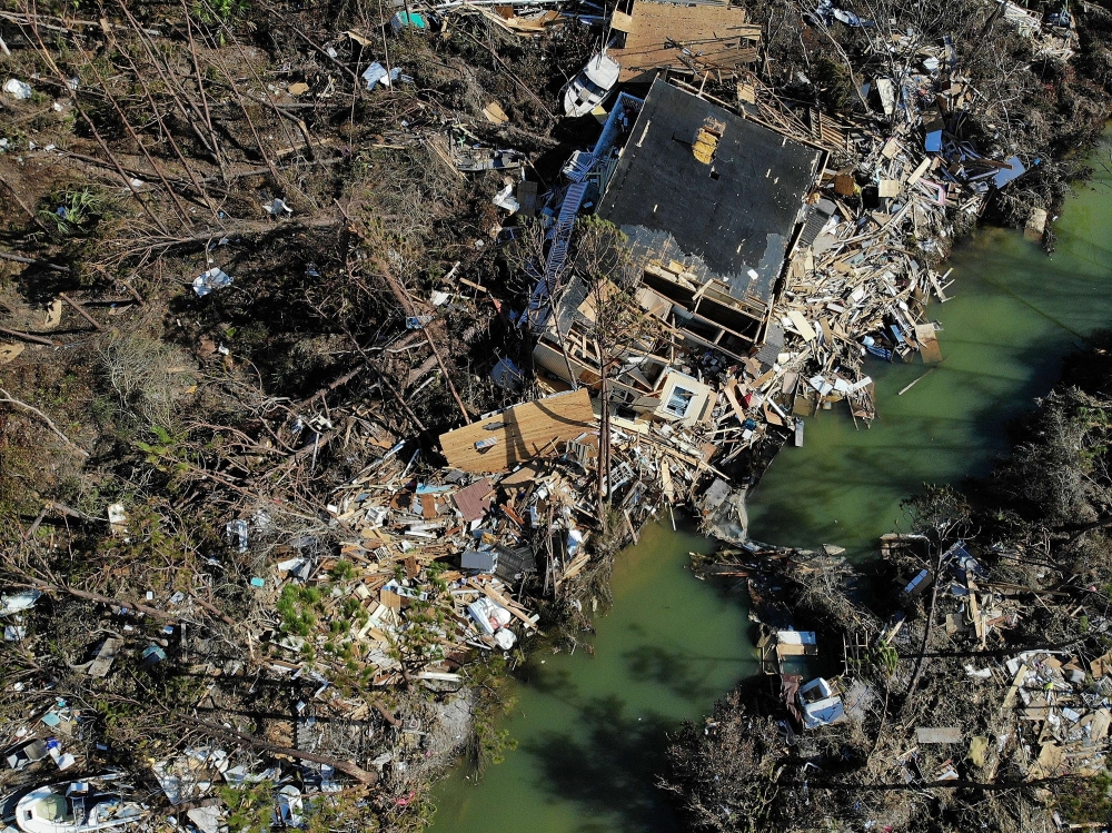 A destroyed house sits in debris and rubble in the aftermath of Hurricane Michael in Mexico Beach, Florida, on Wednesday. — AFP