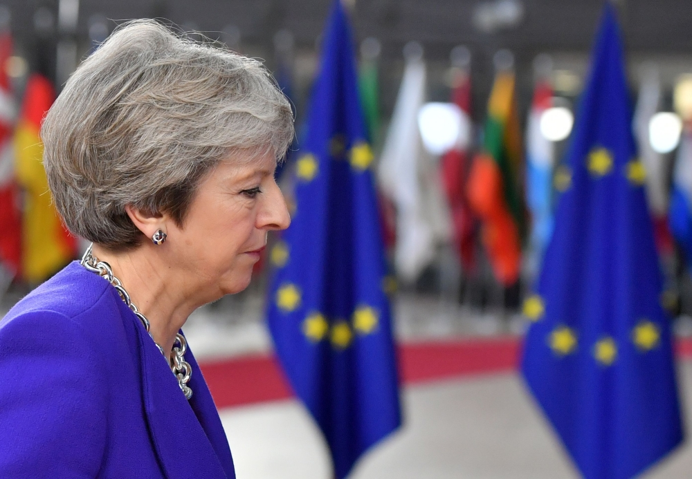 Britain's Prime Minister Theresa May arrives at the European Council in Brussels on Thursday. — AFP