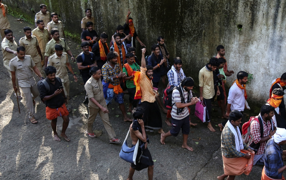 Policemen escort members of the Hindu groups to Pampa base camp, to prevent them from clashing with women of menstrual age entering Sabarimala temple for the first time in centuries, in Pathanamthitta district in the southern state of Kerala, India, on Thursday. — Reuters