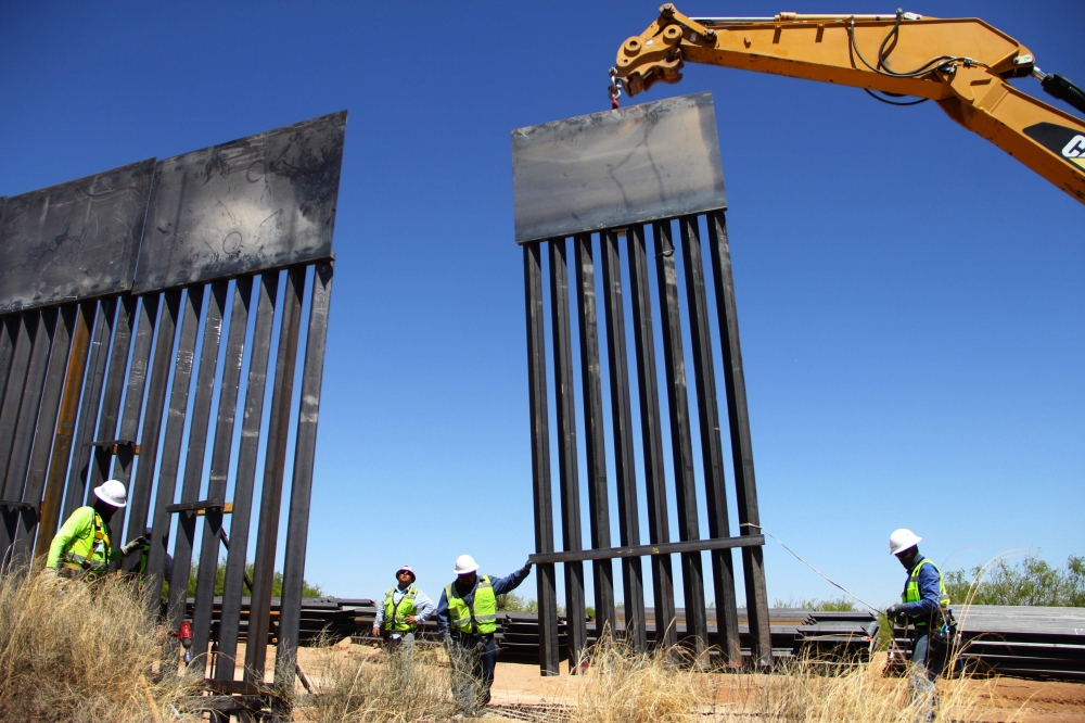 Workers replace an old section of the wall between the US and Mexico in Santa Teresa, New Mexico, close to Ciudad Juarez in Mexico's Chihuahua State, in this April 23, 2018 file photo. — AFP
