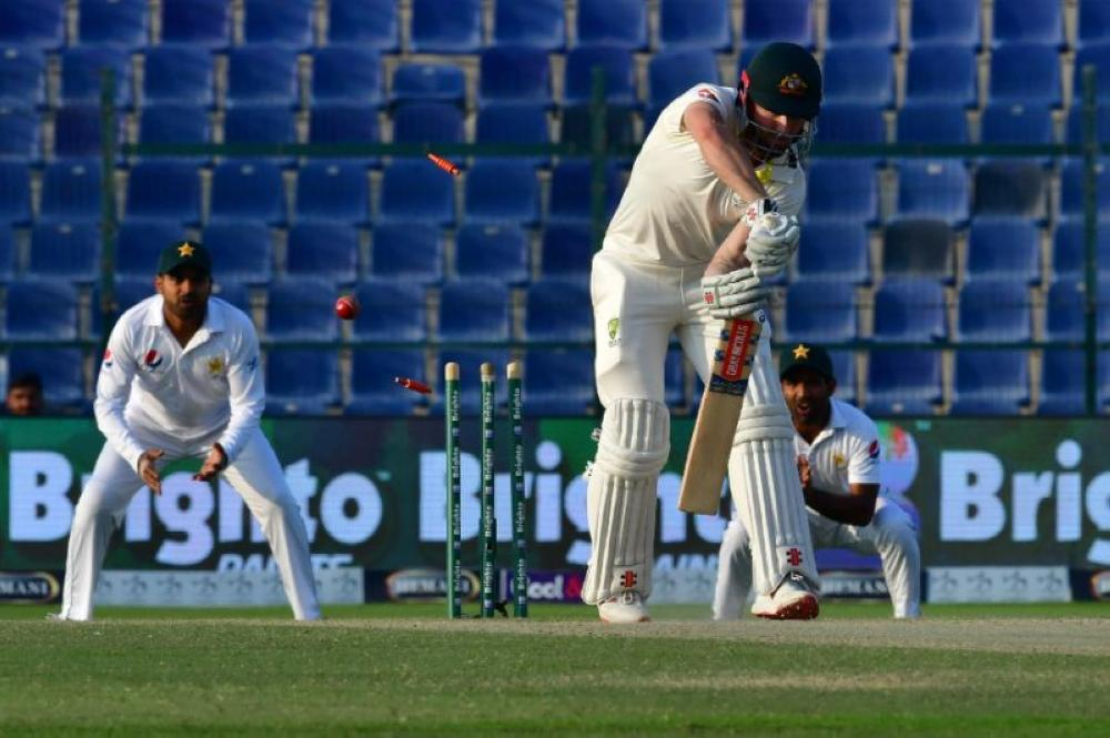 Shaun Marsh was bowled to give Mir Hamza his maiden Test wicket. — AFP