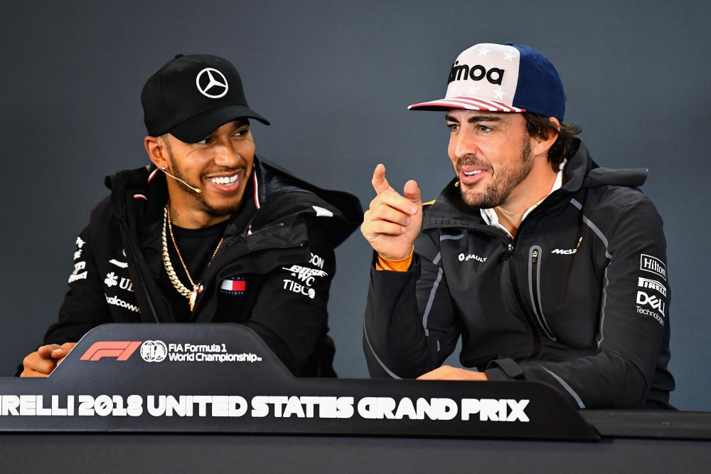 Lewis Hamilton of Great Britain and Mercedes GP and Fernando Alonso of Spain and McLaren F1 talk in the Drivers Press Conference during previews ahead of the United States Formula One Grand Prix at Circuit of The Americas on Thursday in Austin, United States. — AFP