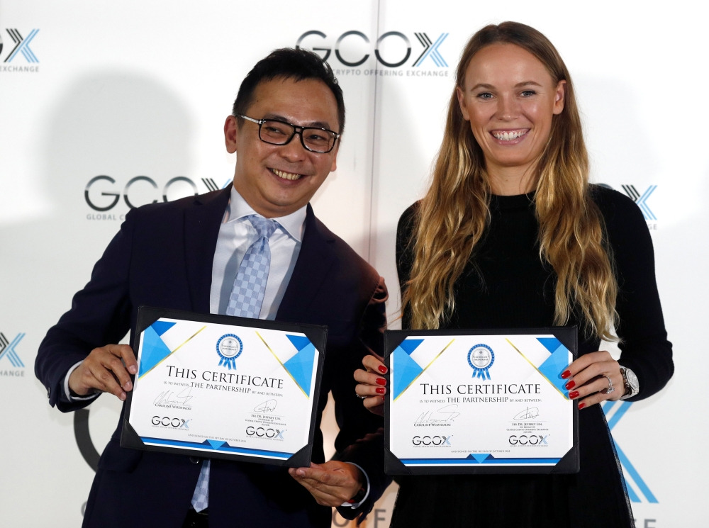 Tennis player Caroline Wozniacki attends a signing ceremony with CEO of GCOX Global Crypto Offering Exchange, Jeffrey Lin, to launch her own cryptocurrency in Singapore on Thursday. — Reuters