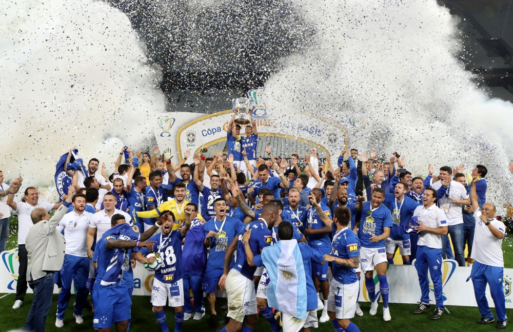 Cruzeiro's players celebrate with the trophy of the Copa do Brasil after beating Corinthians following the finals second leg at the Arena Corinthians Stadium, Sao Paulo, Brazil, on Wednesday. — Reuters