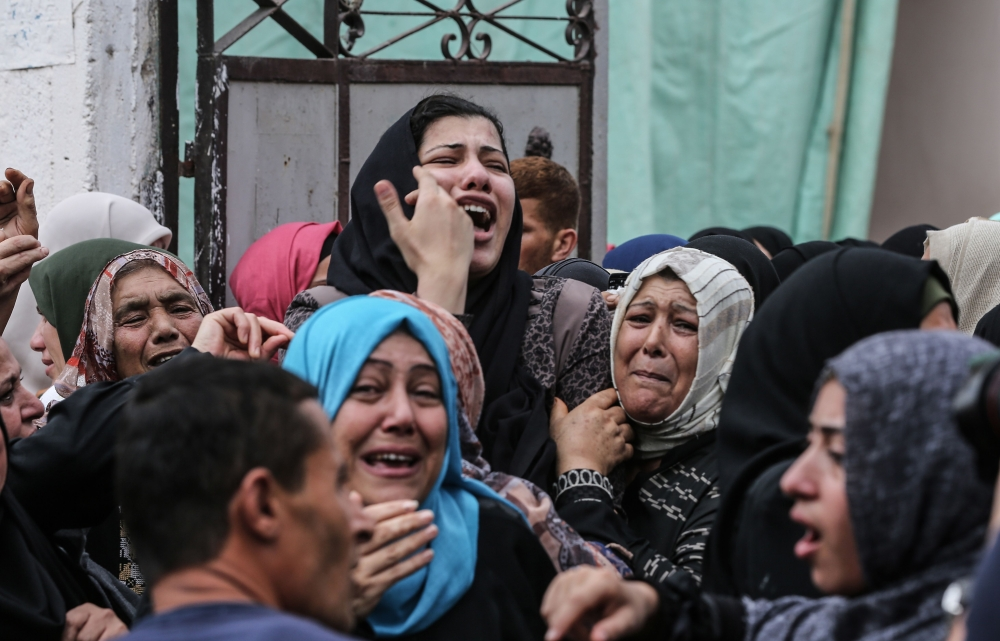 Relatives of Palestinian Naji Al-Za'aneen, 25, mourn during his funeral in the northern Gaza Strip on Wednesday. — AFP