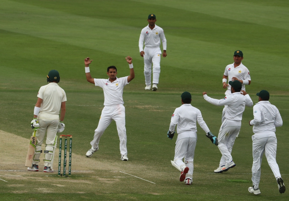 Pakistan bowler Mohammad Abbas (2R) celebrates after dismissing Australian cricketer Marnus Labuschagne during day four of the second Test match between Australia and Pakistan at Sheikh Zayed Stadium in Abu Dhabi on Friday. — AFP