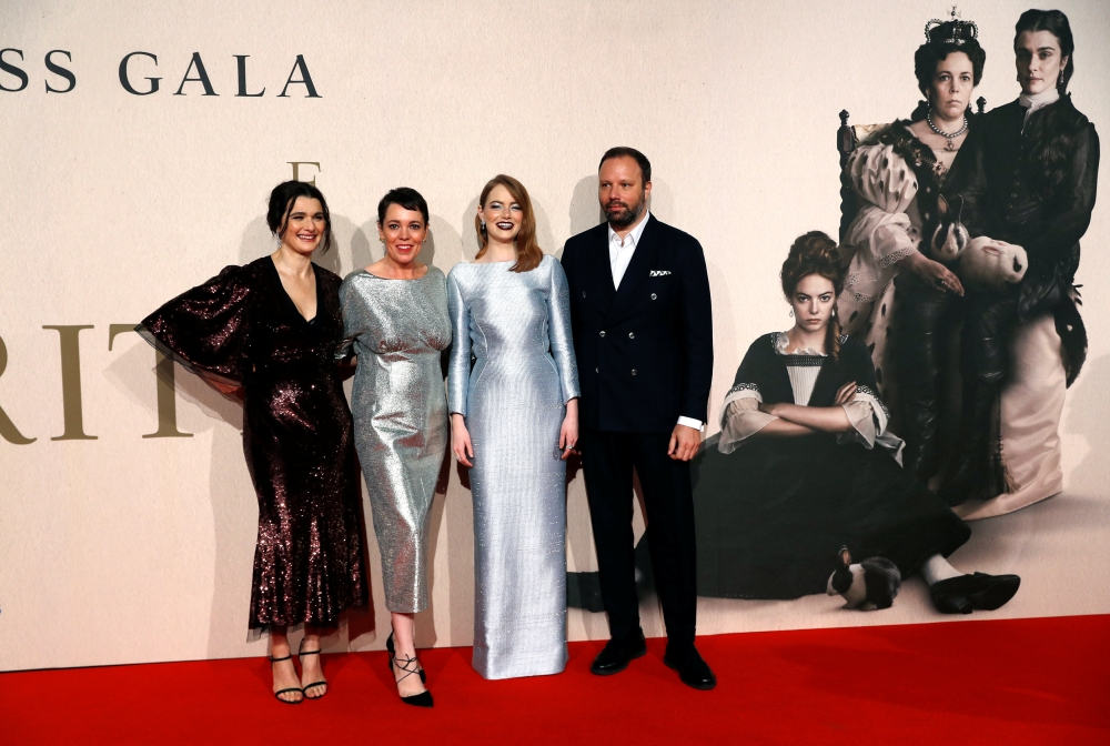 Director Yorgos Lanthimos with Rachel Weisz, Olivia Colman and Emma Stone pose at the UK Premiere of The Favourite during the London Film Festival in London on Thursday. — Reuters