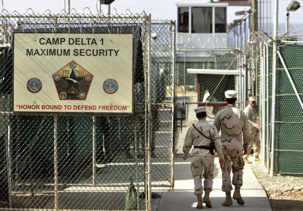 US military guards walk within Camp Delta military-run prison, at the Guantanamo Bay US Naval Base, Cuba, in this file photo — AP