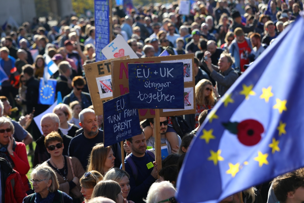 Protesters participating in an anti-Brexit demonstration, march through central London, Saturday. — Reuters