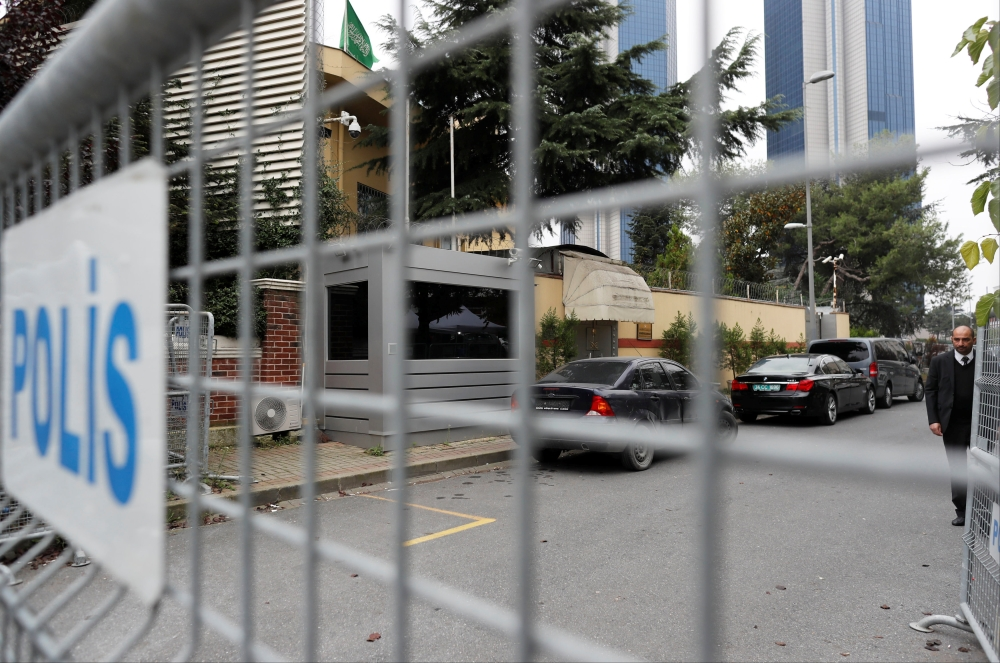 A member of security staff is seen next to the barriers at the gate of Saudi Arabia's consulate in Istanbul, Turkey, on Sunday. — Reuters