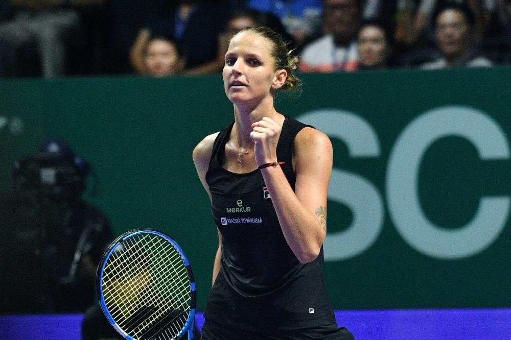 Czech Republic's Karolina Pliskova celebrates after defeating Denmark's Caroline Wozniacki at the WTA Finals in Singapore Sunday. — AFP
