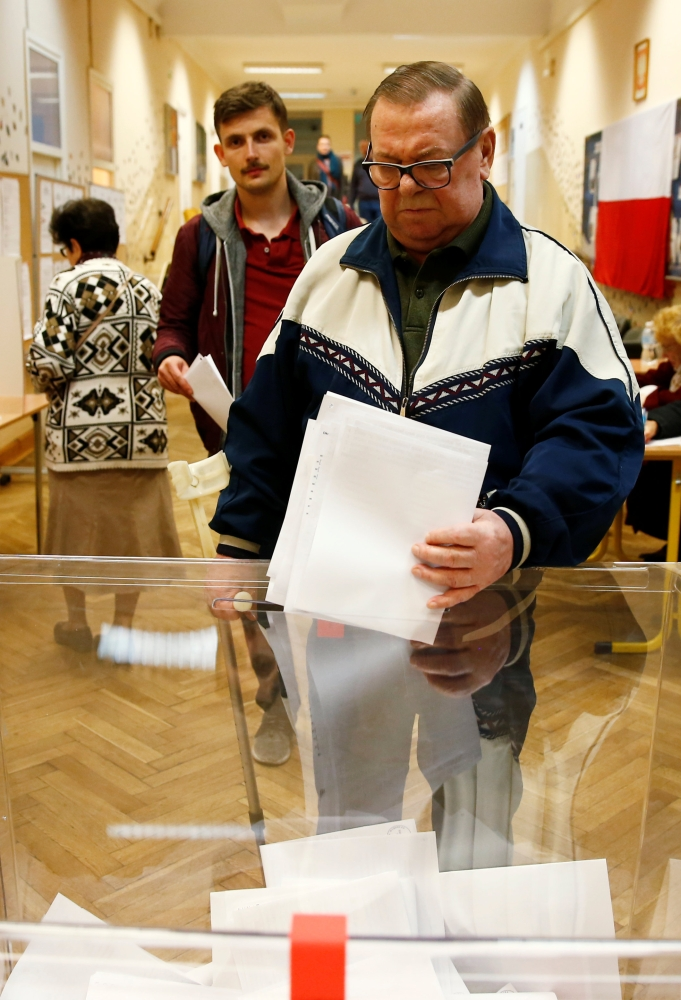 Voting underway during the Polish regional elections, at a polling station in Warsaw, Sunday. — Reuters