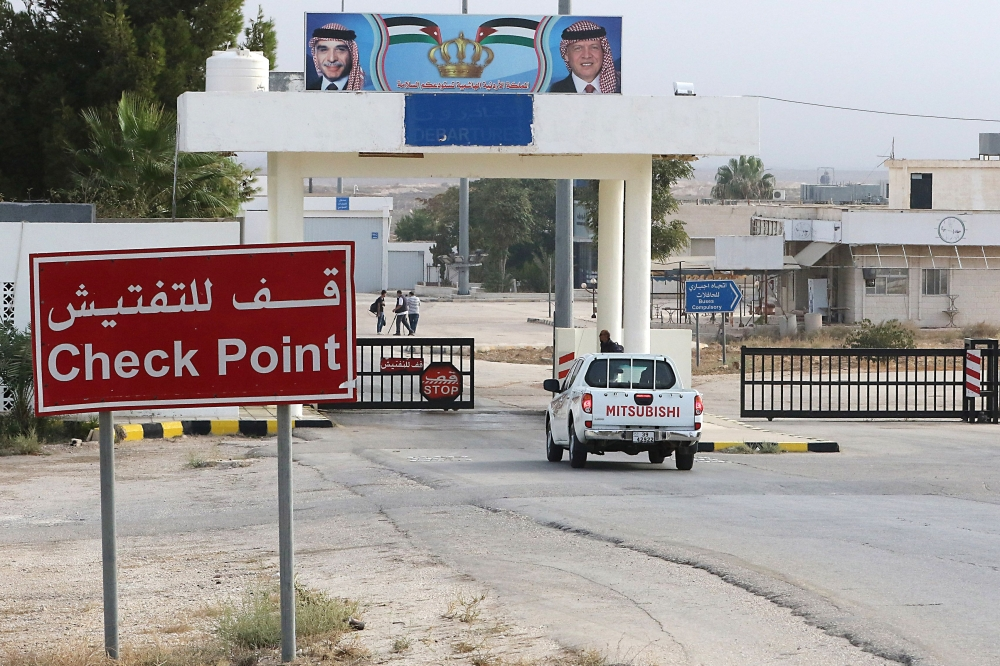A vehicle arrives at the Jaber border crossing between Jordan and Syria (Nassib crossing on the Syrian side) on the day of its reopening in the Jordanian Mafraq governorate last week. — AFP