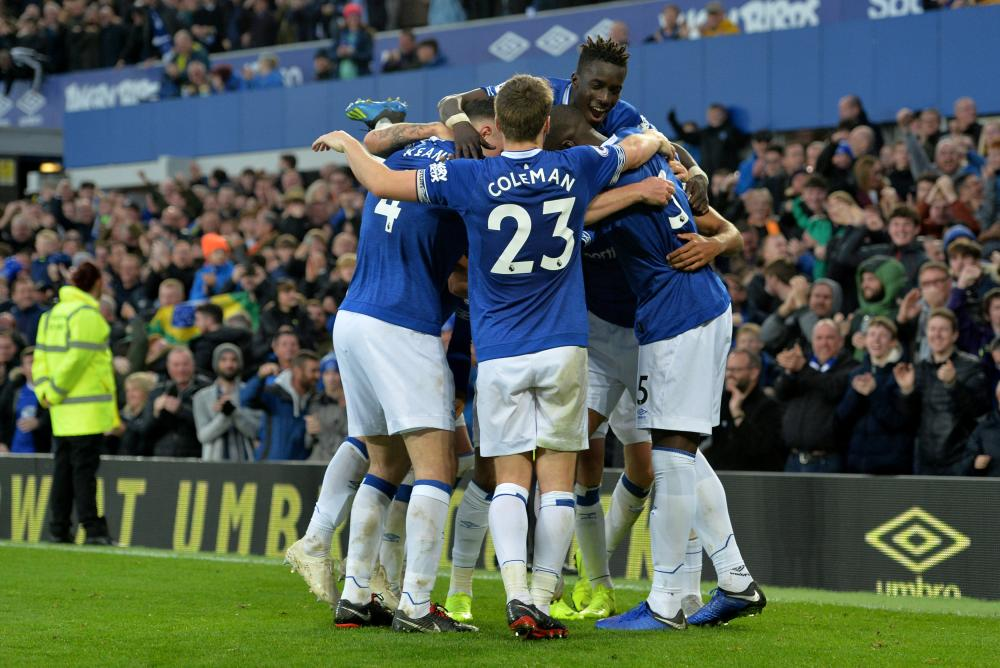 Everton players celebrate scoring against Crystal Palace during their English Premier League match at Goodison Park, Liverpool, Sunday. — Reuters
