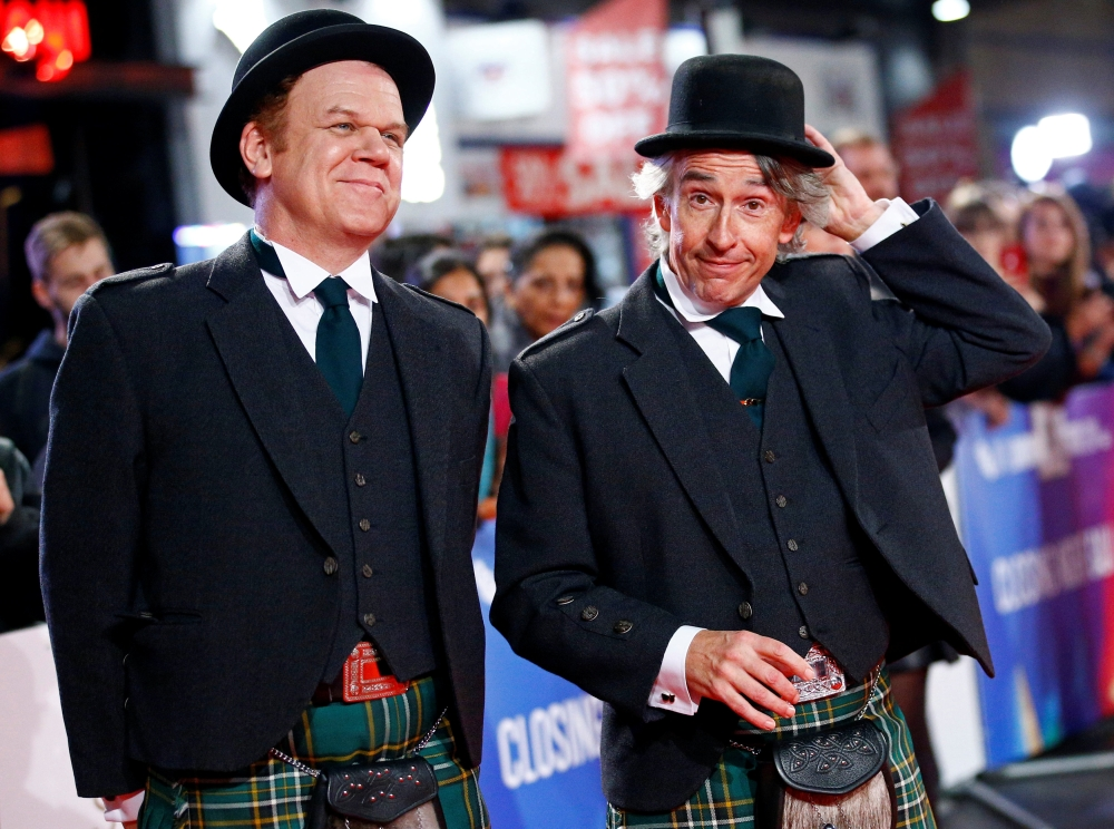 "Actors John C. Reilly and Steve Coogan arrive at the world premiere of ""Stan and Ollie"" during the London Film Festival, in London. — Reuters"