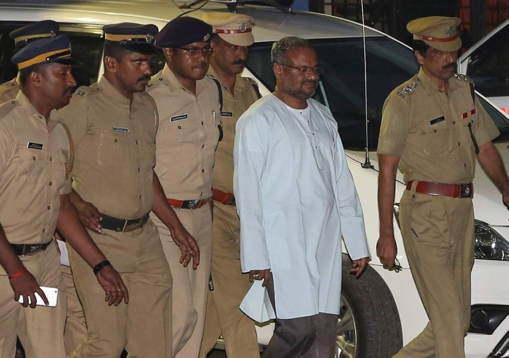 Bishop Franco Mulakkal, dressed in white, is escorted by police in Kochi, India, in this file photo. — Reuters