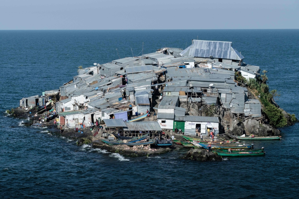 The picture tshows a general view of Migingo island which is densely populated by residents fishing mainly for Nile perch in Lake Victoria on the border of Uganda and Kenya. A rounded rocky outcrop covered in metallic shacks, Migingo Island rises out of the waters of Lake Victoria like an iron-plated turtle. — AFP