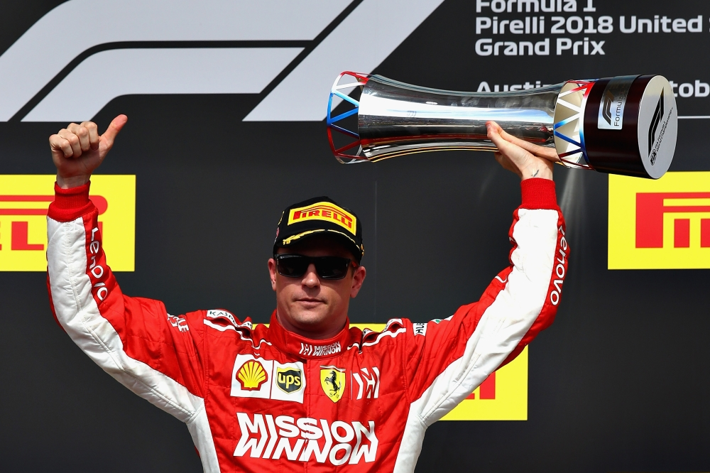 Race winner Kimi Raikkonen of Finland and Ferrari celebrates on the podium during the US Formula One Grand Prix at Circuit of The Americas in Austin Sunday. — AFP
