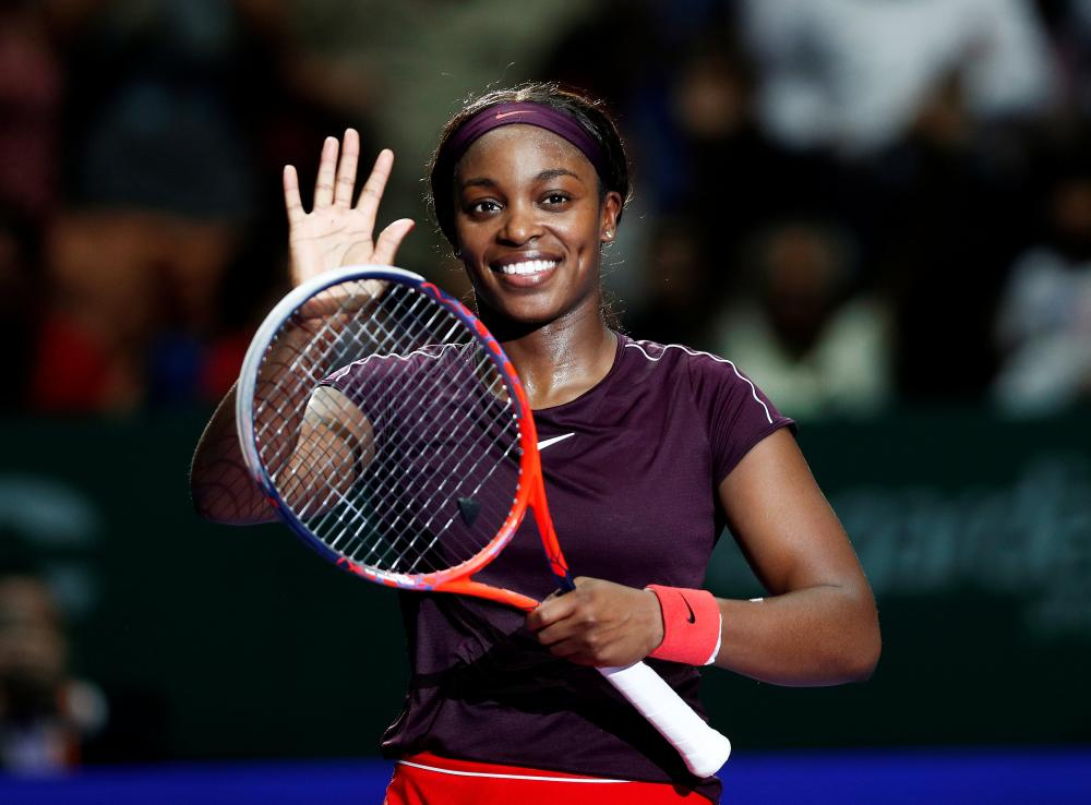 Sloane Stephens of the US celebrates winning her group stage match against Japan's Naomi Osaka at the WTA Finals in Singapore Monday. — Reuters