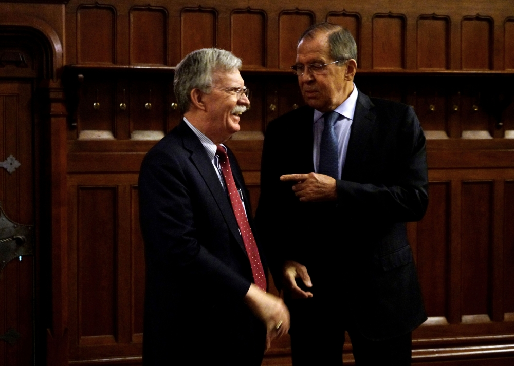 John Bolton, left, National Security Adviser to the US President, speaks with Russian Foreign Minister Sergei Lavrov during their meeting focused on nuclear treaty in Moscow on Monday. — AFP