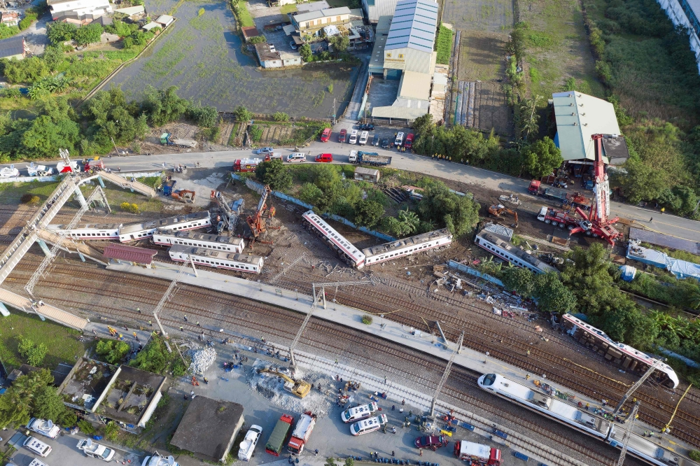 A general view shows carriages of the Puyuma Express train in Taiwan's northeastern Yilan county on Monday, a day after the train derailed at high speed near Xinma station. — AFP