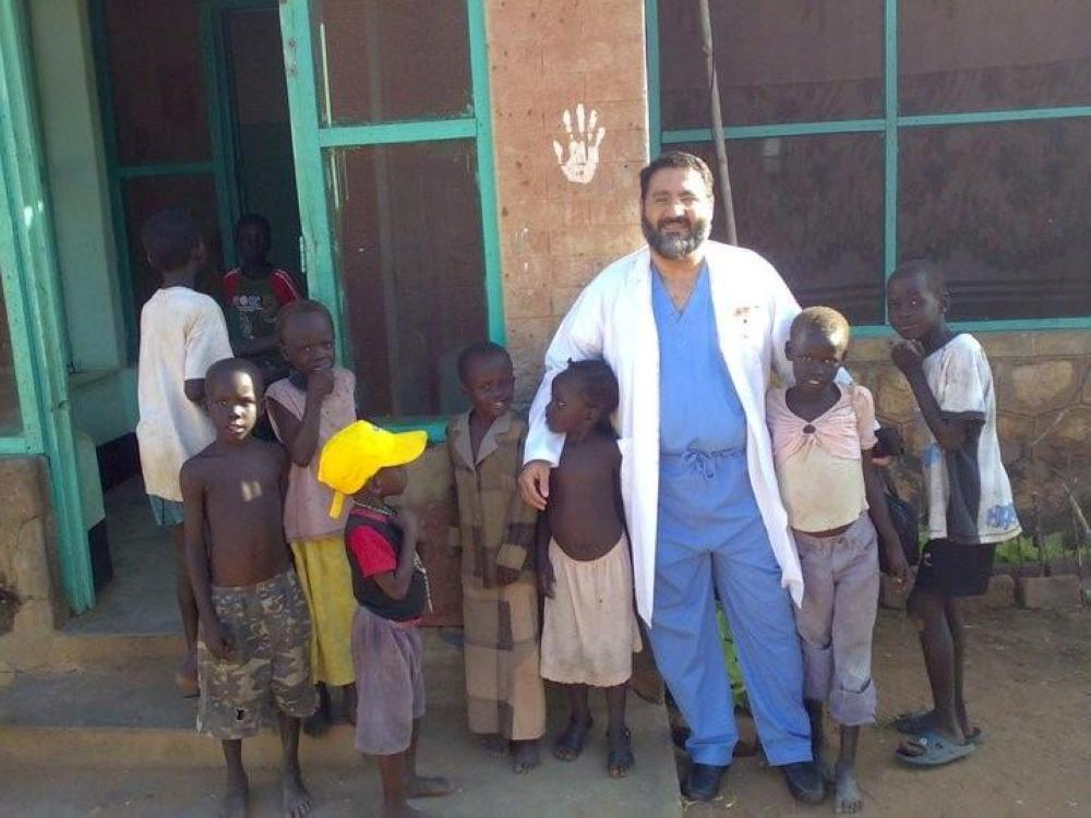 Dr. Khalid Al-Otaibi with his patients in an African country. The Saudi endoscopic surgeon believes that reaching out to patients is more compassionate than making them travel to the clinics.