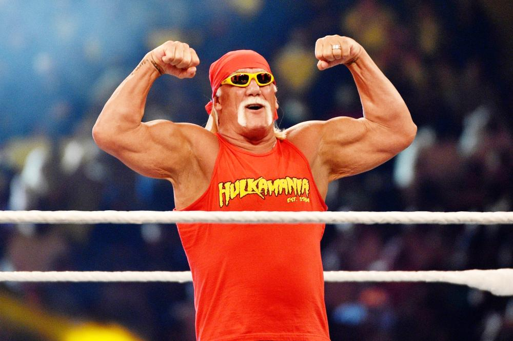 Wrestling legend Hulk Hogan greets the crowd during the WWE Crown Jewel show at the King Saud University Stadium in Riyadh Friday. — AFP