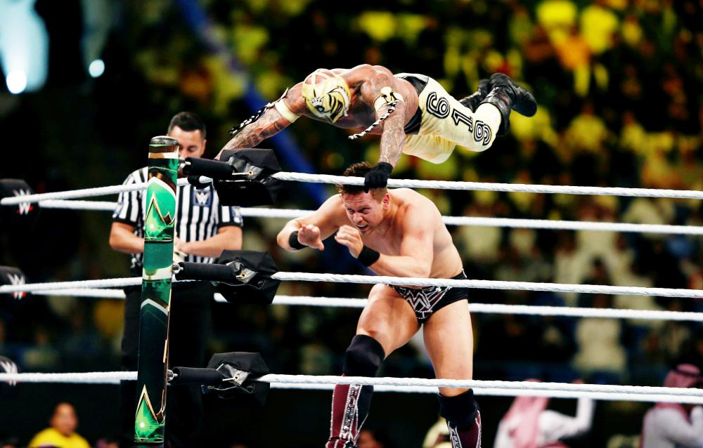 Rey Mysterio in action against The Miz during the WWE Crown Jewel show at King Saud University Stadium in Riyadh Friday. — Reuters