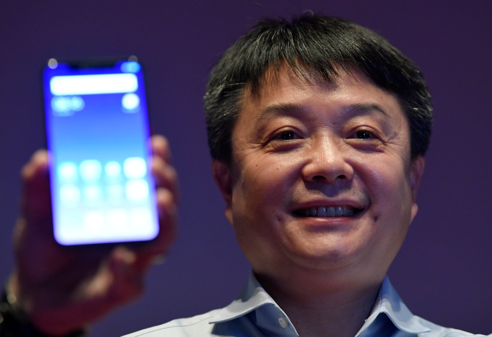 Senior vice president of Xiaomi, Xiang Wang, poses on stage during a UK launch event in London, Britain, on Thursday. — Reuters