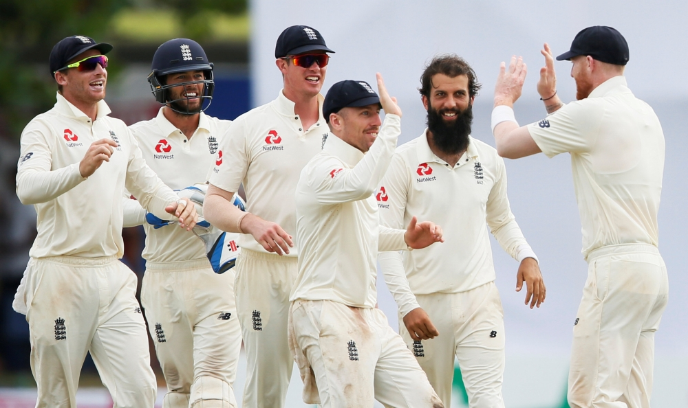 England's Moeen Ali (2nd R) celebrates with his teammates Ben Stokes (R), Jack Leach (C), Keaton Jennings (3rd L), Ben Foakes (2nd L) and Jos Buttler after taking the wicket of Sri Lanka's Niroshan Dickwella (not pictured) during the First Test at Galle on Friday. — Reuters