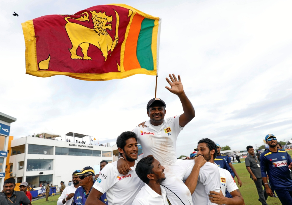 Sri Lanka's Rangana Herath waves at fans after the hosts lost to England during the First Test at Galle on Friday. — Reuters