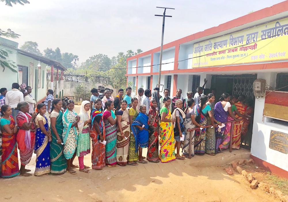 Indian voters line up to vote at a polling station in Sukma in Chhattisgarh state on Monday. — AFP