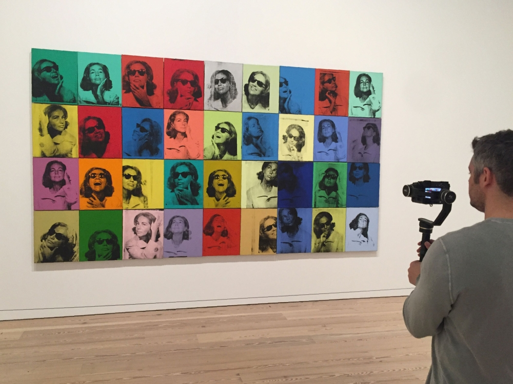 "A man films the painting ""Ethel Scull 36 Times"" (1963) by late US artist Andy Warhol during a press preview of the exhibition ""Andy Warhol — From A to B and Back Again"" at the Whitney Museum in New York in this Nov. 6, 2018 file photo. — AFP"