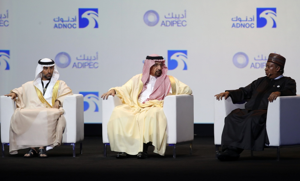 UAE's Energy Minister Suhail Mohammed Faraj Al-Mazroui (L), Saudi Energy Minister Khalid Al-Falih (C) and OPEC Secretary General Mohammed Barkindo attend the Abu Dhabi International Petroleum Exhibition and Conference (ADIPEC) on Monday in the Emirati capital. — AFP
