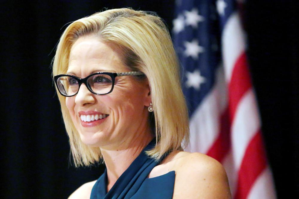 Democratic candidate Kyrsten Sinema speaks to supporters after officially winning the US Senate race at the Omni Montelucia resort in Scottsdale, Arizona, on Monday. — Reuters