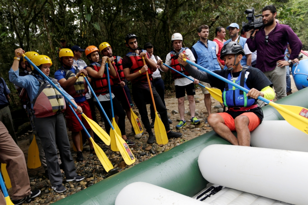 Duberney Moreno, former rebel of the FARC, rafting guide and instructor, speaks with a group of the press and government representatives before boarding an inflatable raft in Miravalle, Colombia, in this Nov. 9, 2018 file photo. — Reuters