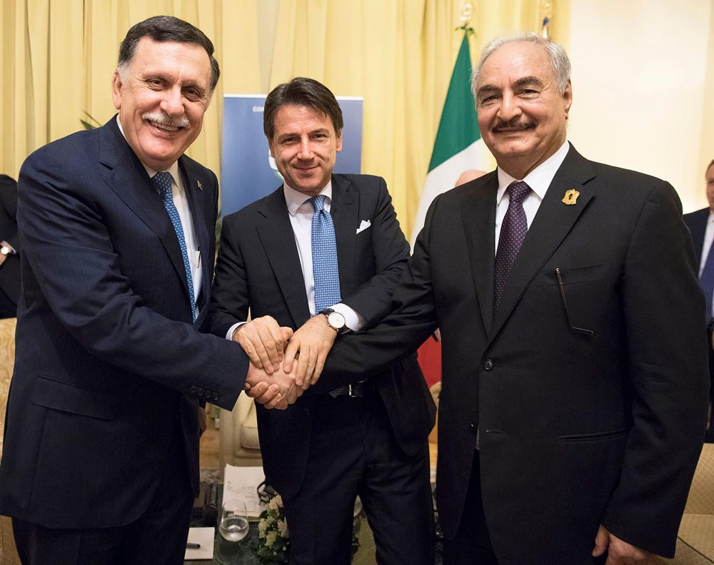 Italian Prime Minister Giuseppe Conte (center) poses with head of the UN-backed unity government in Tripoli, Prime Minister Fayez Al-Sarraj (left) and Libya Chief of Staff, Marshall Khalifa Haftar on the sidelines of an international conference on Libya in Palermo. — AFP